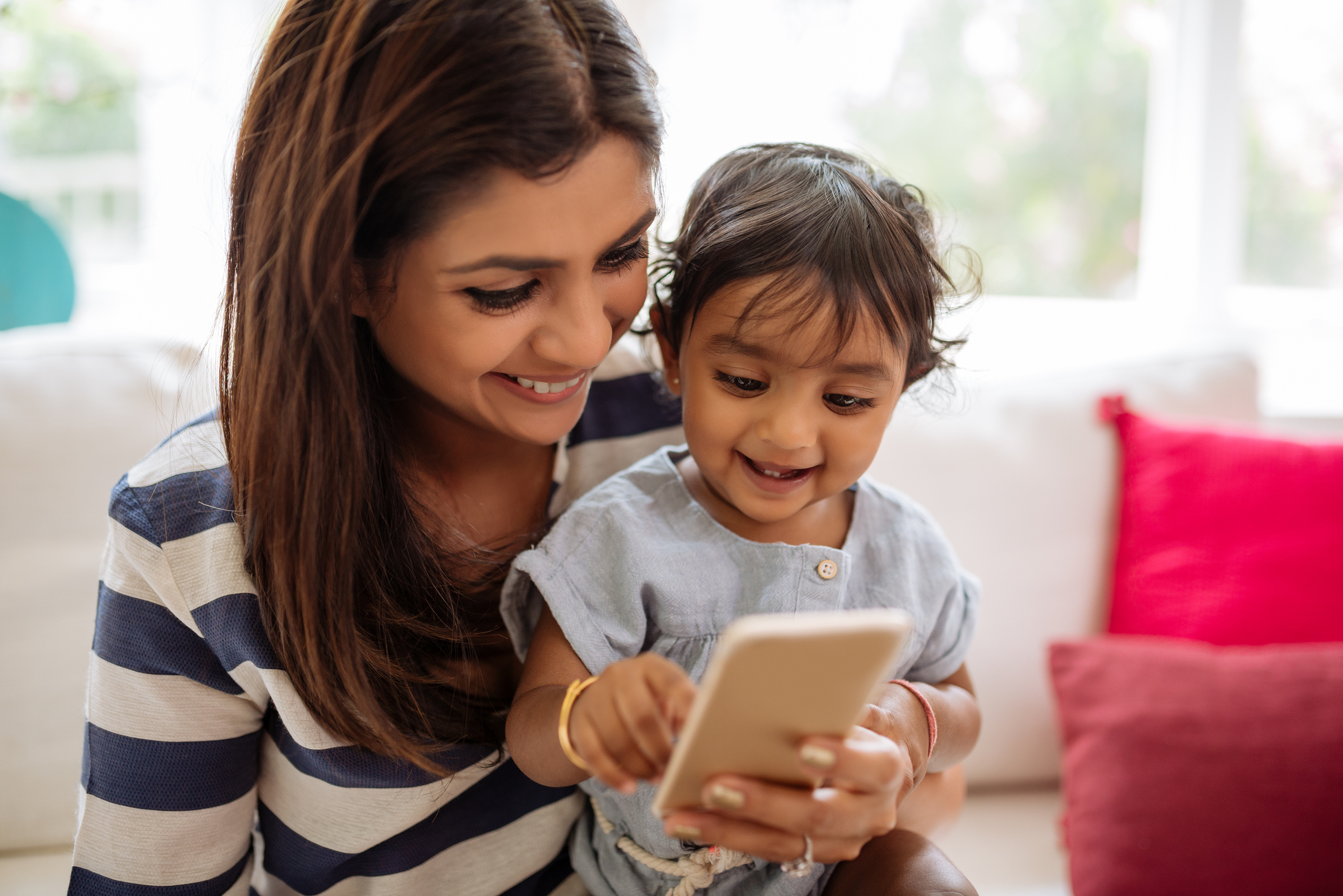 Mother and child using phone app