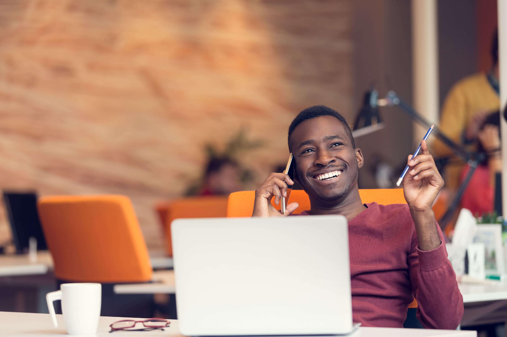 Person on phone at office