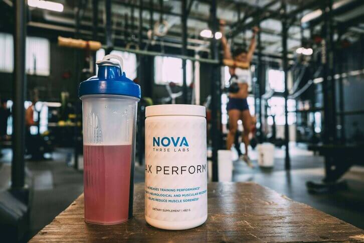 Nova 3 Labs supplement shake and bottle with gym backgrop