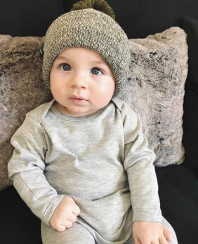 Baby wearing heather gray onesie with gray knit hat