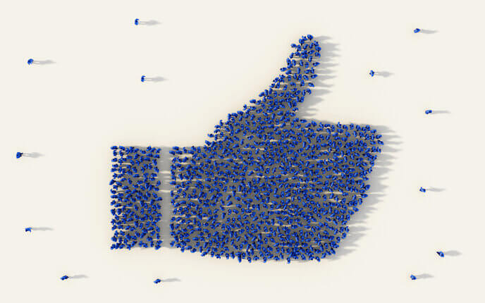 Overhead of people forming a thumb icon