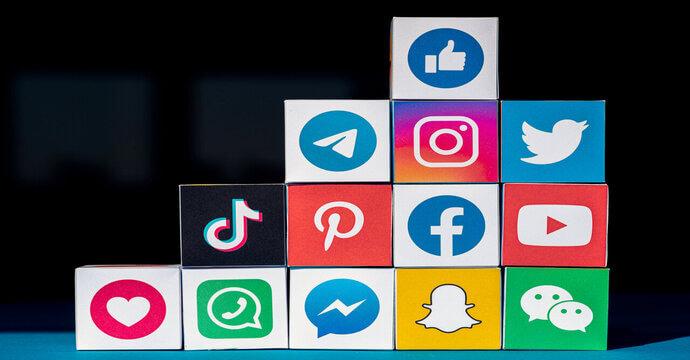 Blocks stacked up showing a variety of social media logos