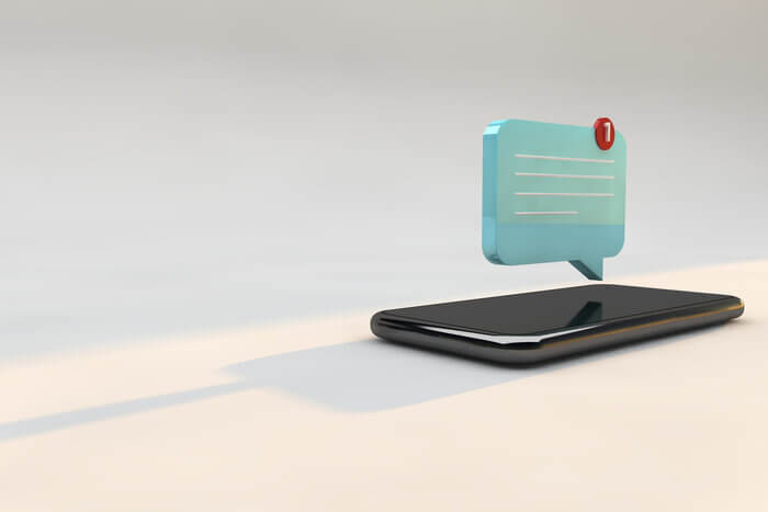 Phone with 3D illustration of push notification