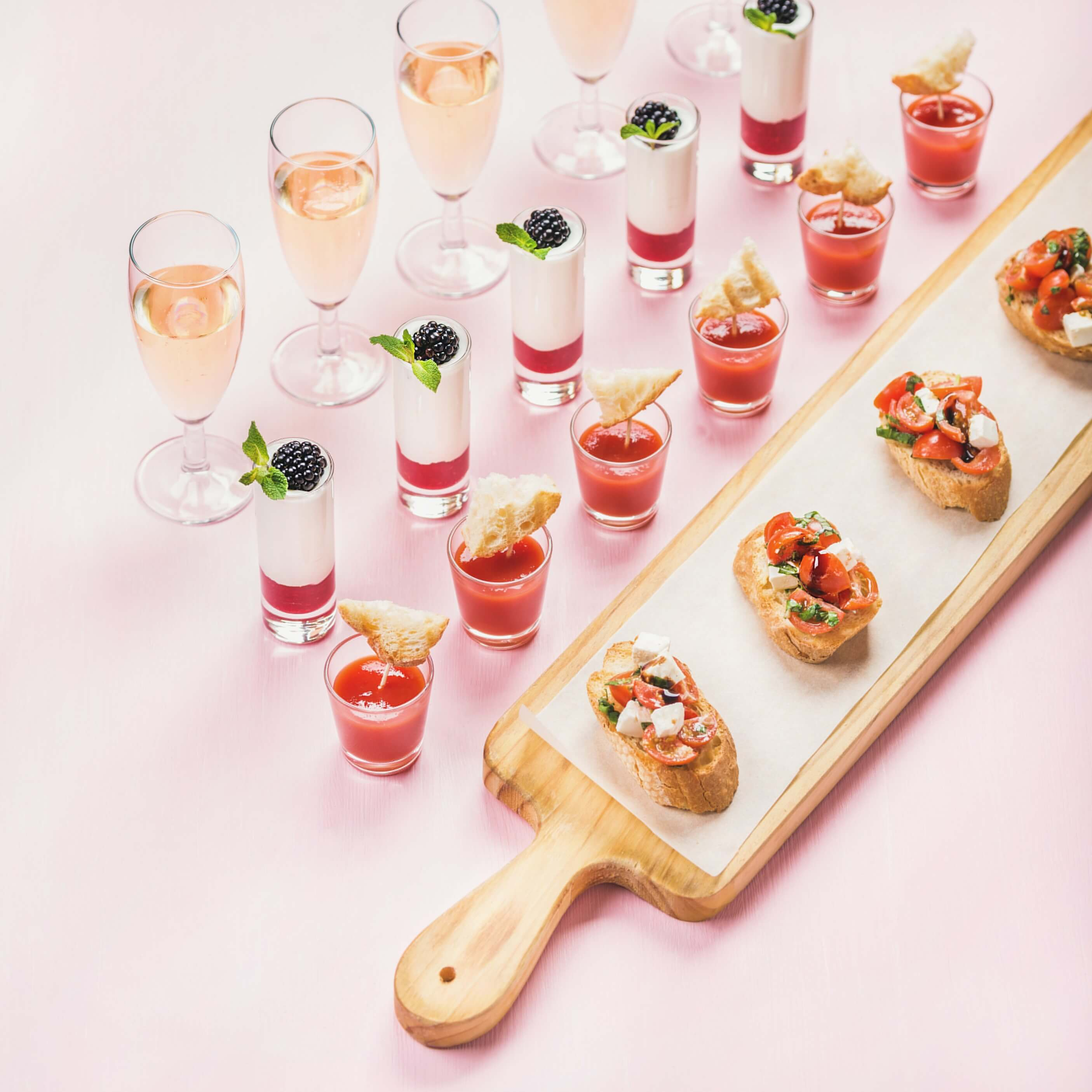 Catering spread on pink background